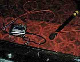 a MiniDisc player on the stage floor; a common sight these days