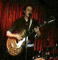 Jen Turrell with guitar